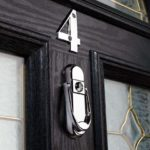 affinity-chrome-door-knocker-on-black-door_b166528c-f0d2-4f6e-8b1e-fc1817bb167a-1.jpg